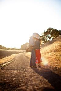 Borges_Couple_cowboy_hats_kiss_Lovelight_photo
