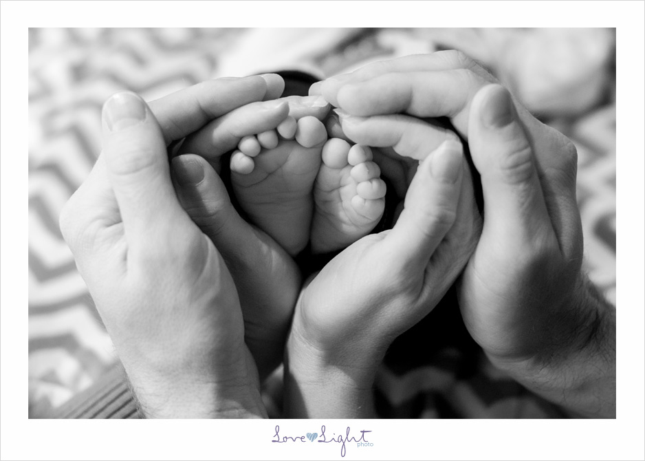 newborn family hands feet christmas