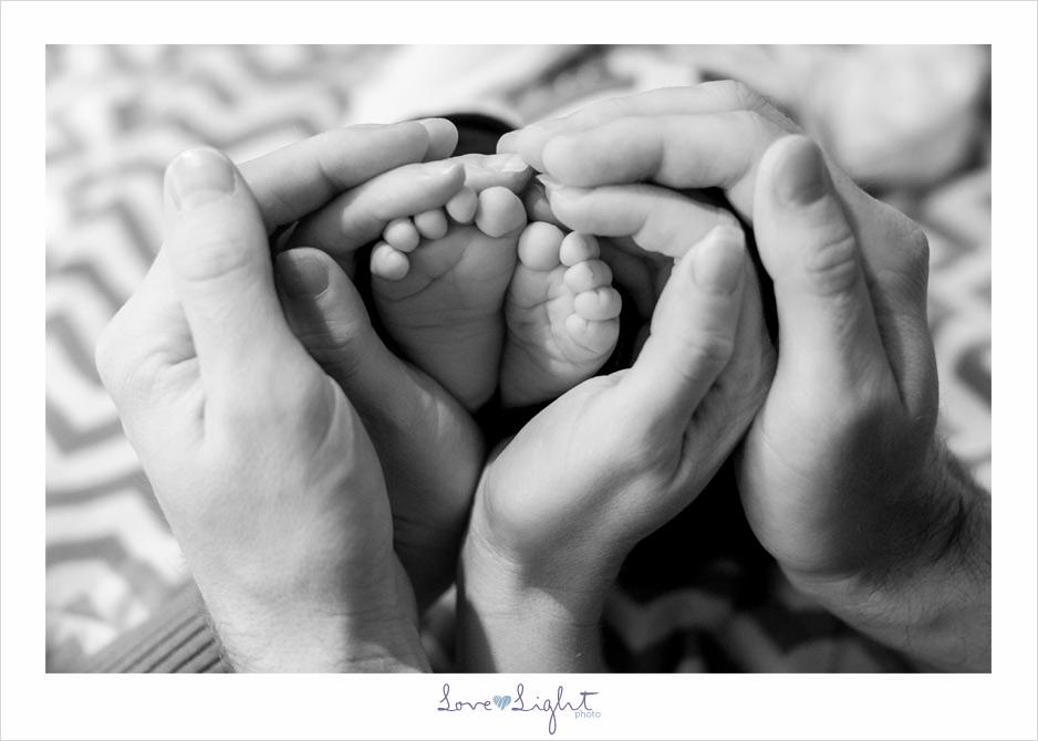 newborn family hands feet christmas