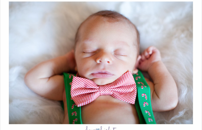 Newborn baby boy at Christmas time photo session