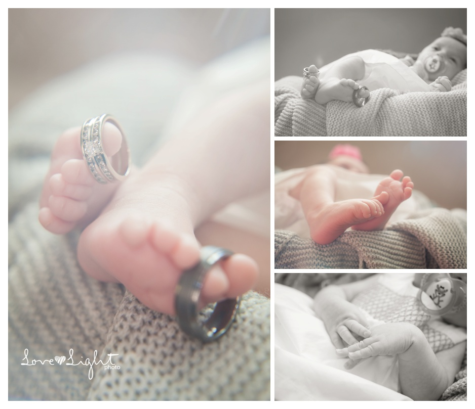 newborn baby with wedding rings on toes